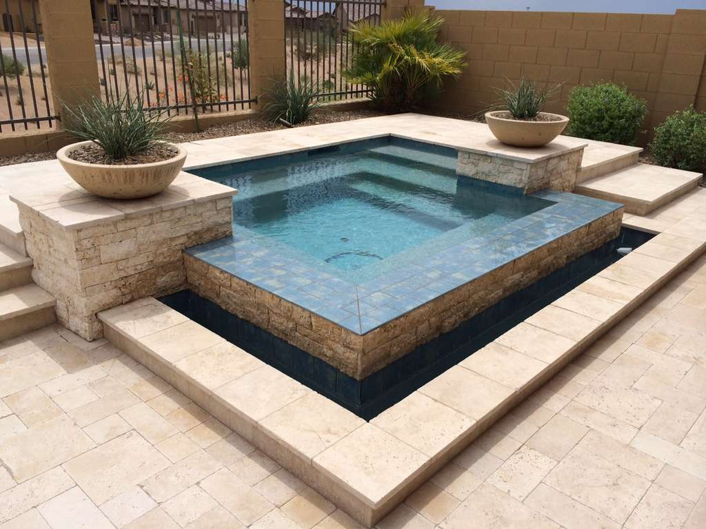 schmelke_project-_negative_edge_spa_white_stack_stone_travertine_deck-_dave