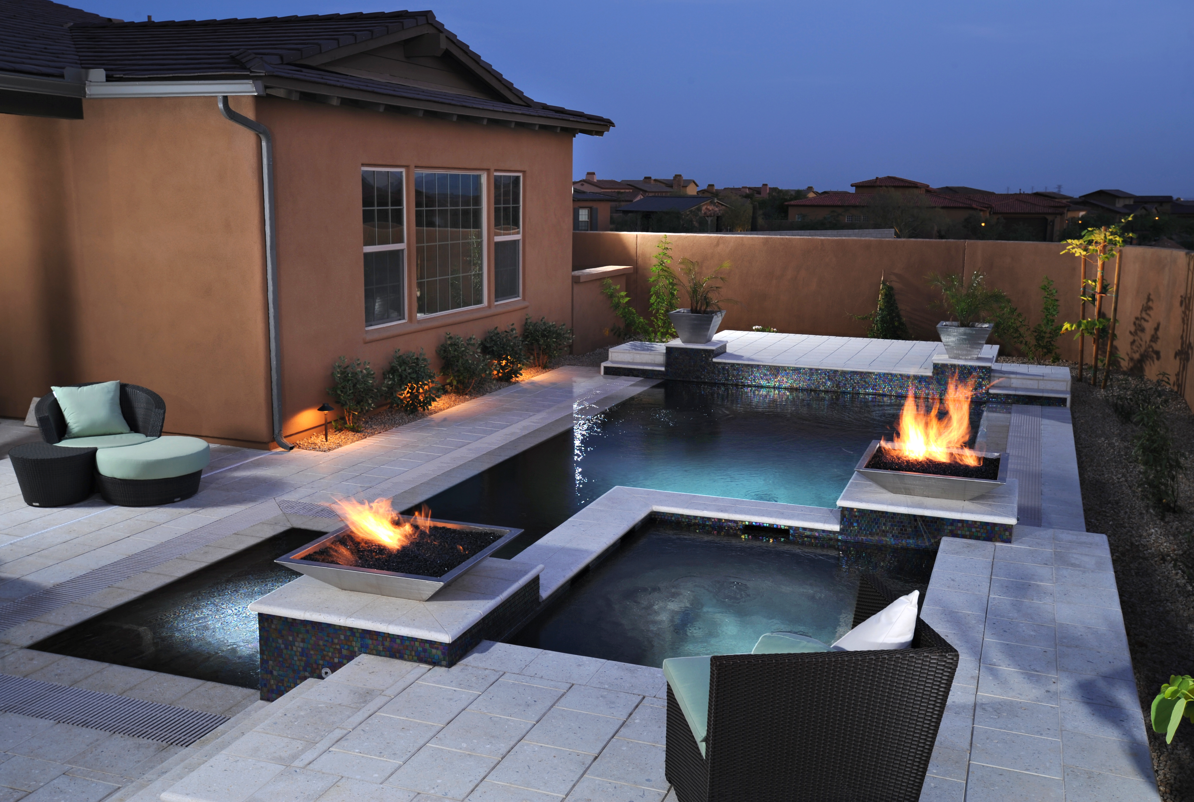artistic paver stone decking • california pools & landscape