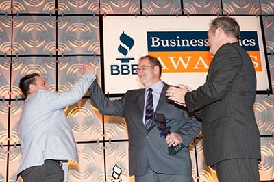 Mike and Jeremy High Fiving After Receiving Award