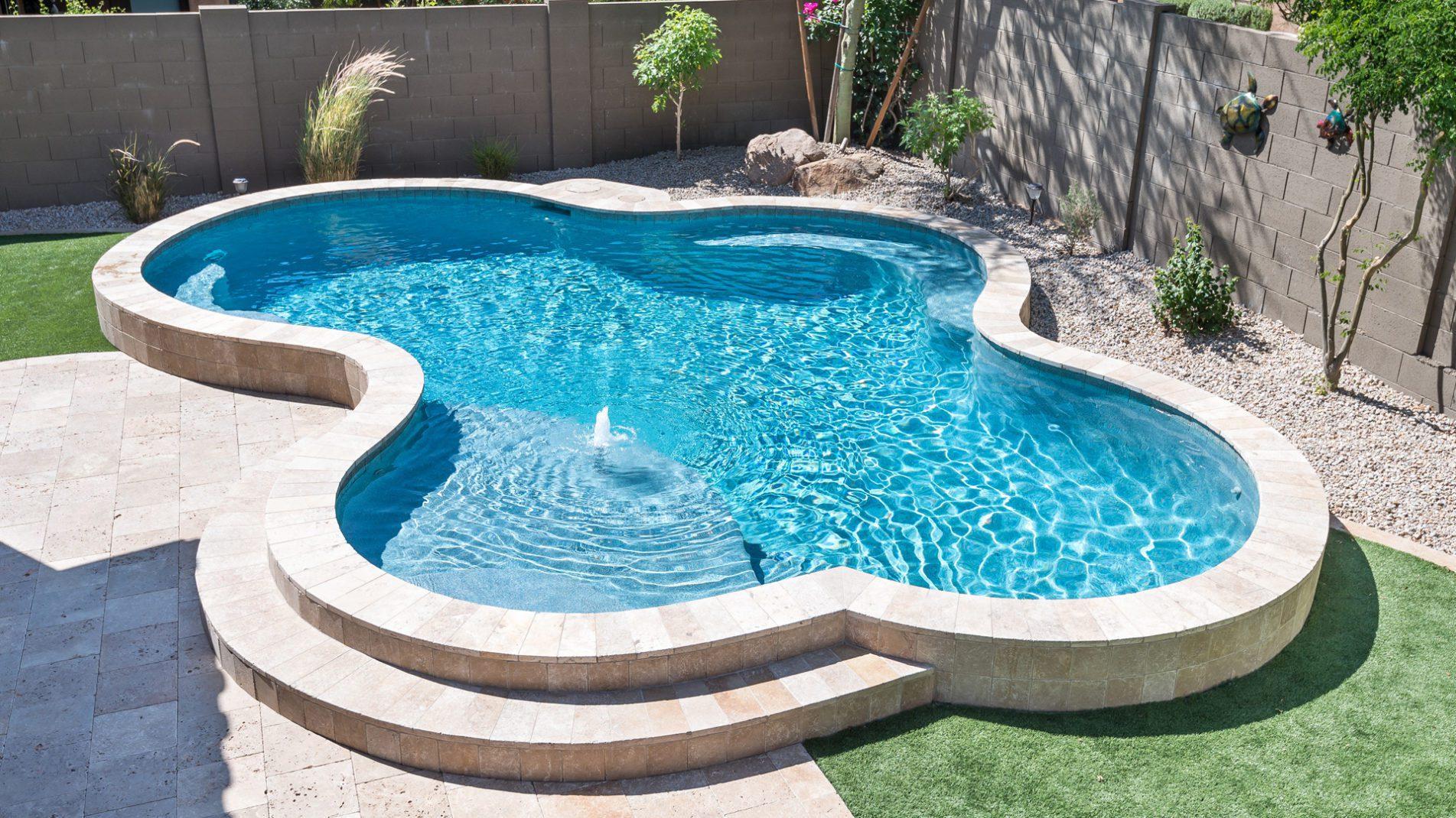 Small Backyard Pool Design Ideas: Raised Freeform Fun